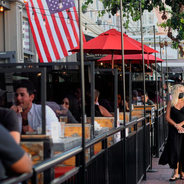 Patrons dine at an outdoor restaurant along 5th Avenue in The Gaslamp Quarter in downtown San Diego on July 17, 2020. (SANDY HUFFAKER/AFP via Getty Images)