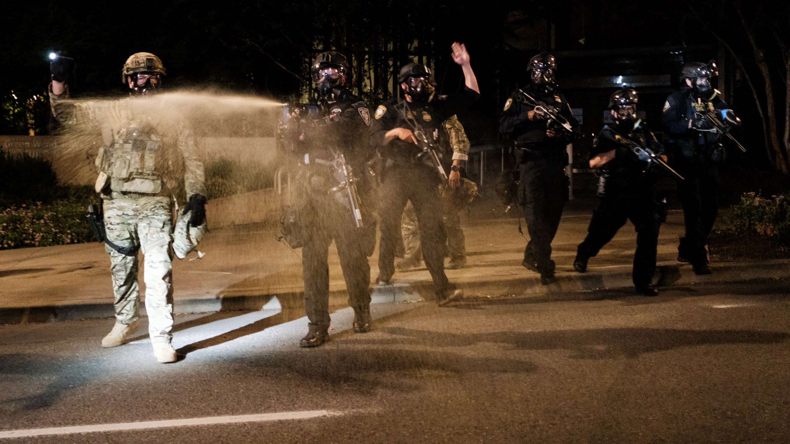 Federal officers use tear gas on protesters outside the Multnomah County Justice Center on July 17, 2020 in Portland, Oregon. (Mason Trinca/Getty Images)