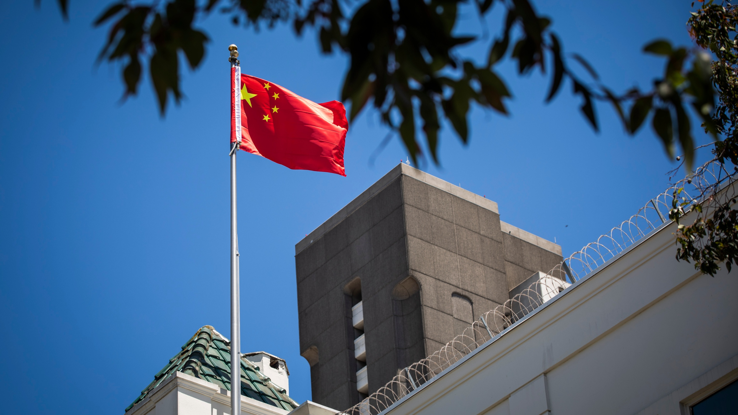 The flag of the People's Republic of China flies in the wind above the Consulate General of the People's Republic of China in San Francisco, on July 23, 2020. The U.S. Justice Department announced on July 23, 2020, the indictments of four Chinese researchers it said lied about their ties to the People's Liberation Army, with one escaping arrest by taking refuge in the country's San Francisco consulate. (Philip Pacheco / AFP via Getty Images)