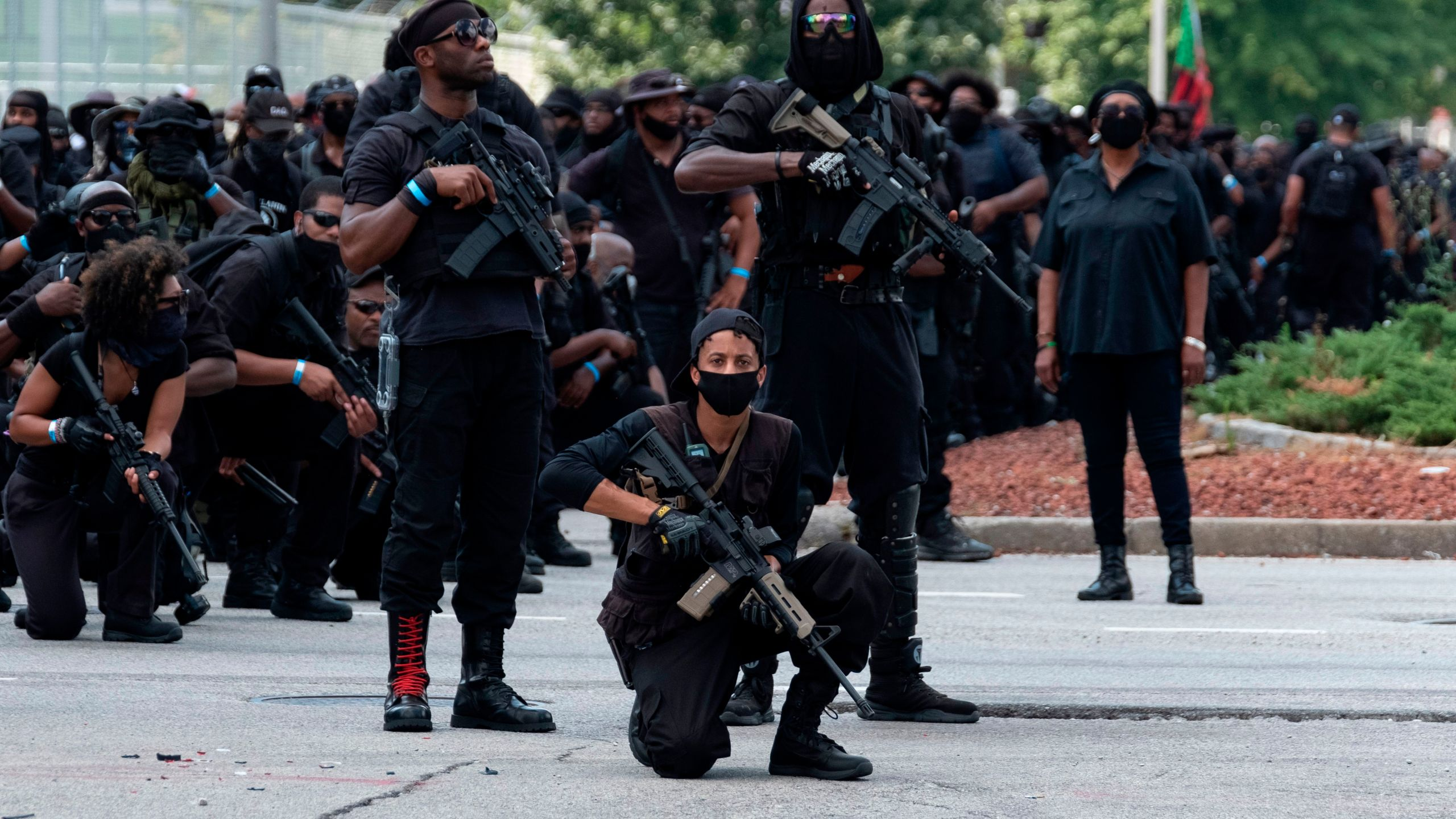 "Members of the ""Not F---ing Around Coalition"" (NFAC), an all black militia, march during a rally to protest the killing of Breonna Taylor, in Louisville, Kentucky on July 25, 2020. (JEFF DEAN/AFP via Getty Images)"