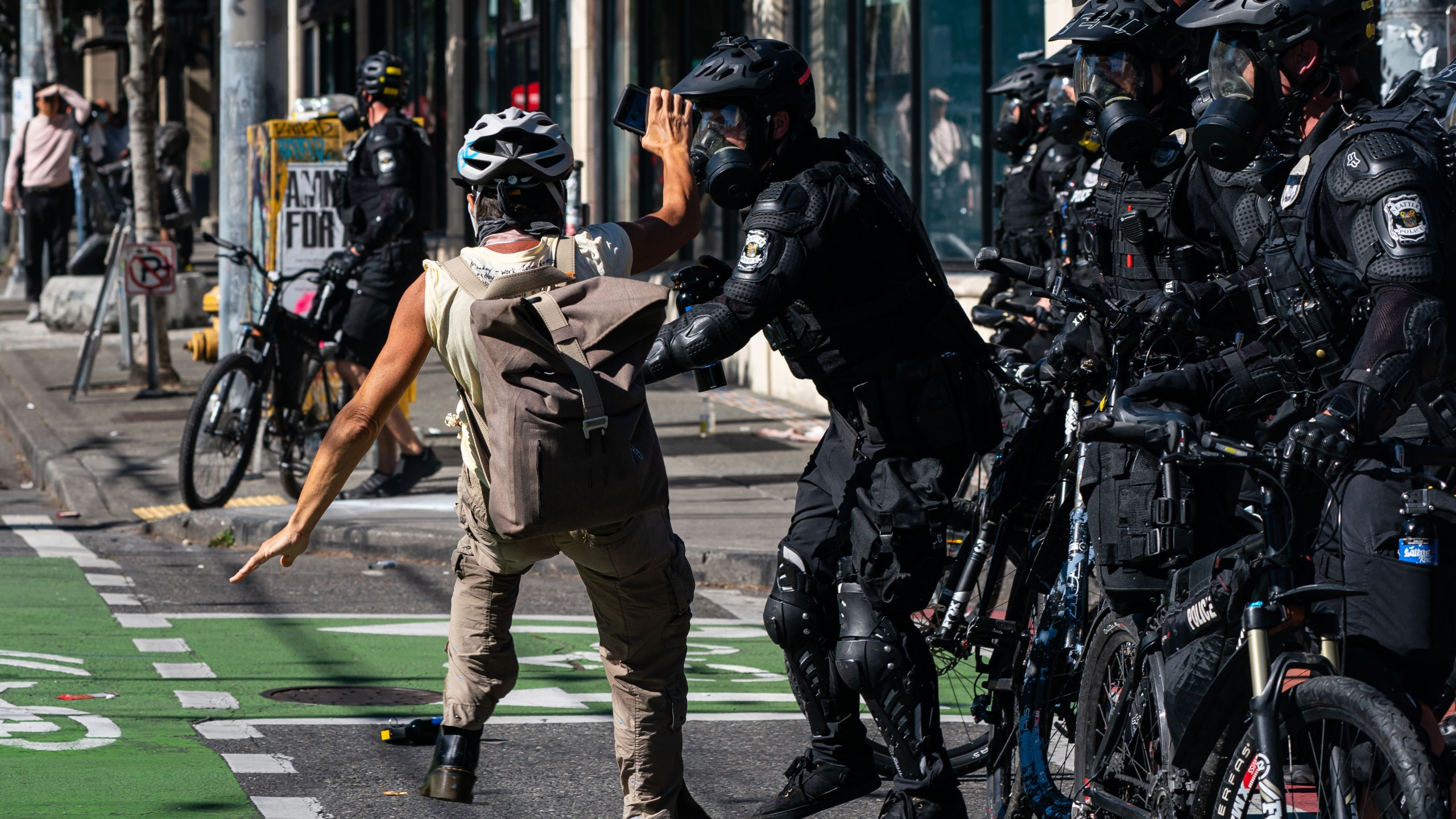 Police push a demonstrator to the ground during protests on July 25, 2020, in Seattle, Washington. (David Ryder/Getty Images)