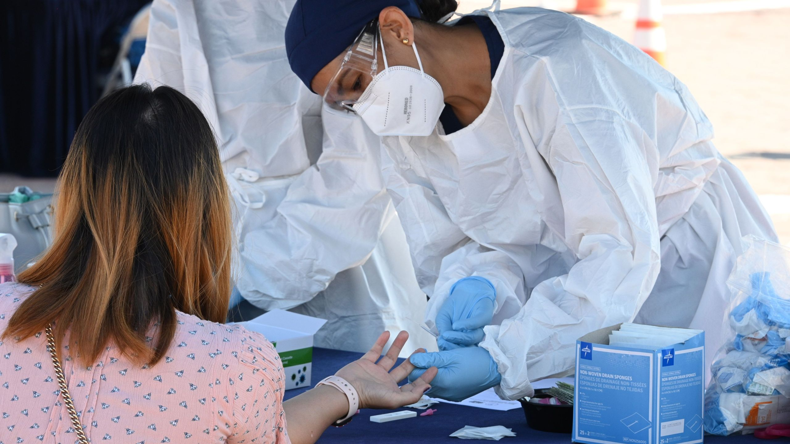 A person undergoes a finger prick blood sample as part of a coronavirus antibody rapid serological test on July 26, 2020 in San Dimas, California, 30 miles east of Los Angeles. (ROBYN BECK/AFP via Getty Images)