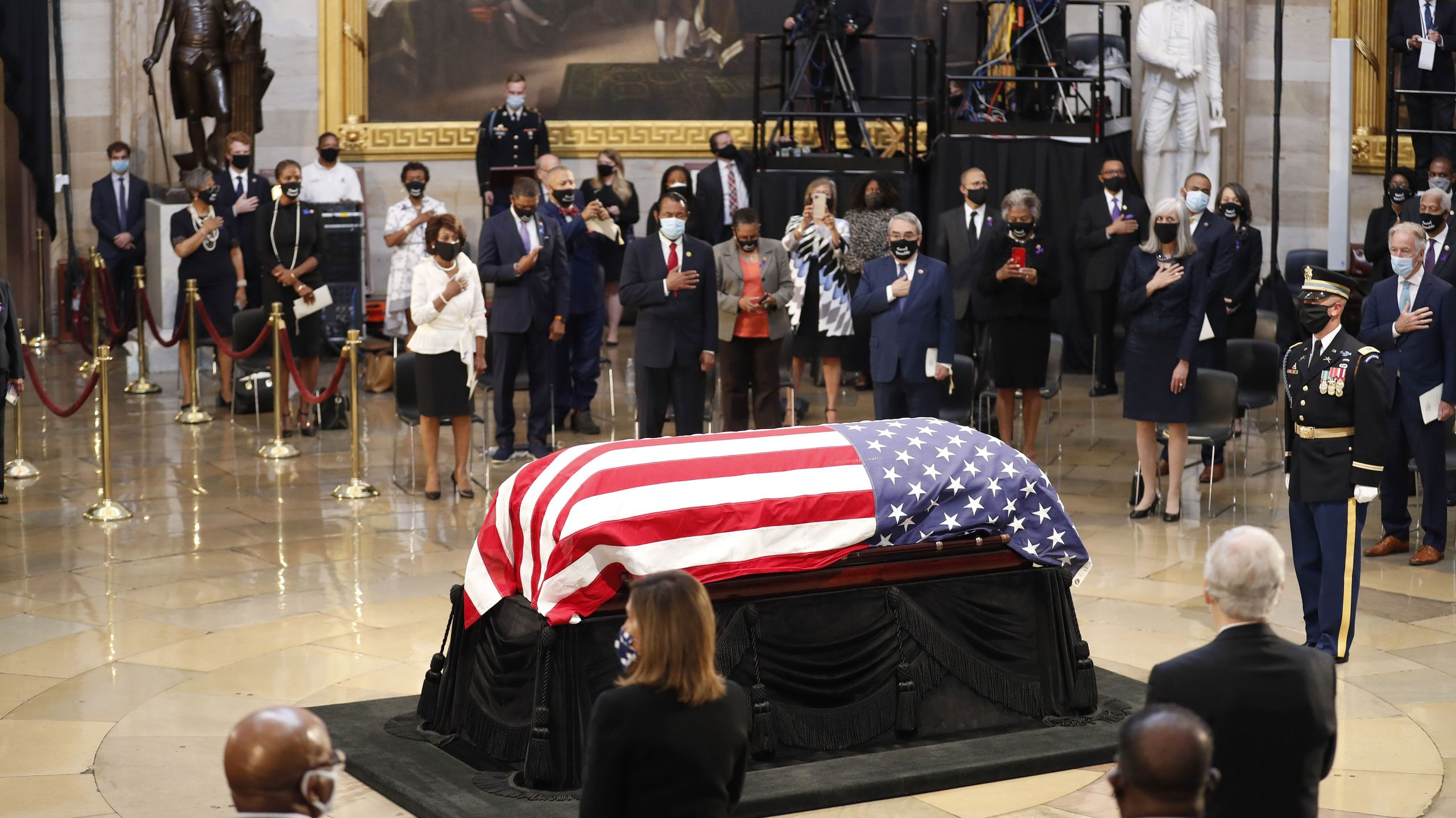 The flag-draped casket of the late Rep. John Lewis, D-GA, is carried by a joint services military honor guard, as he arrives to lie in state in the Rotunda of the US Capitol in Washington, DC, on July 27, 2020. (SHAWN THEW/POOL/AFP via Getty Images)