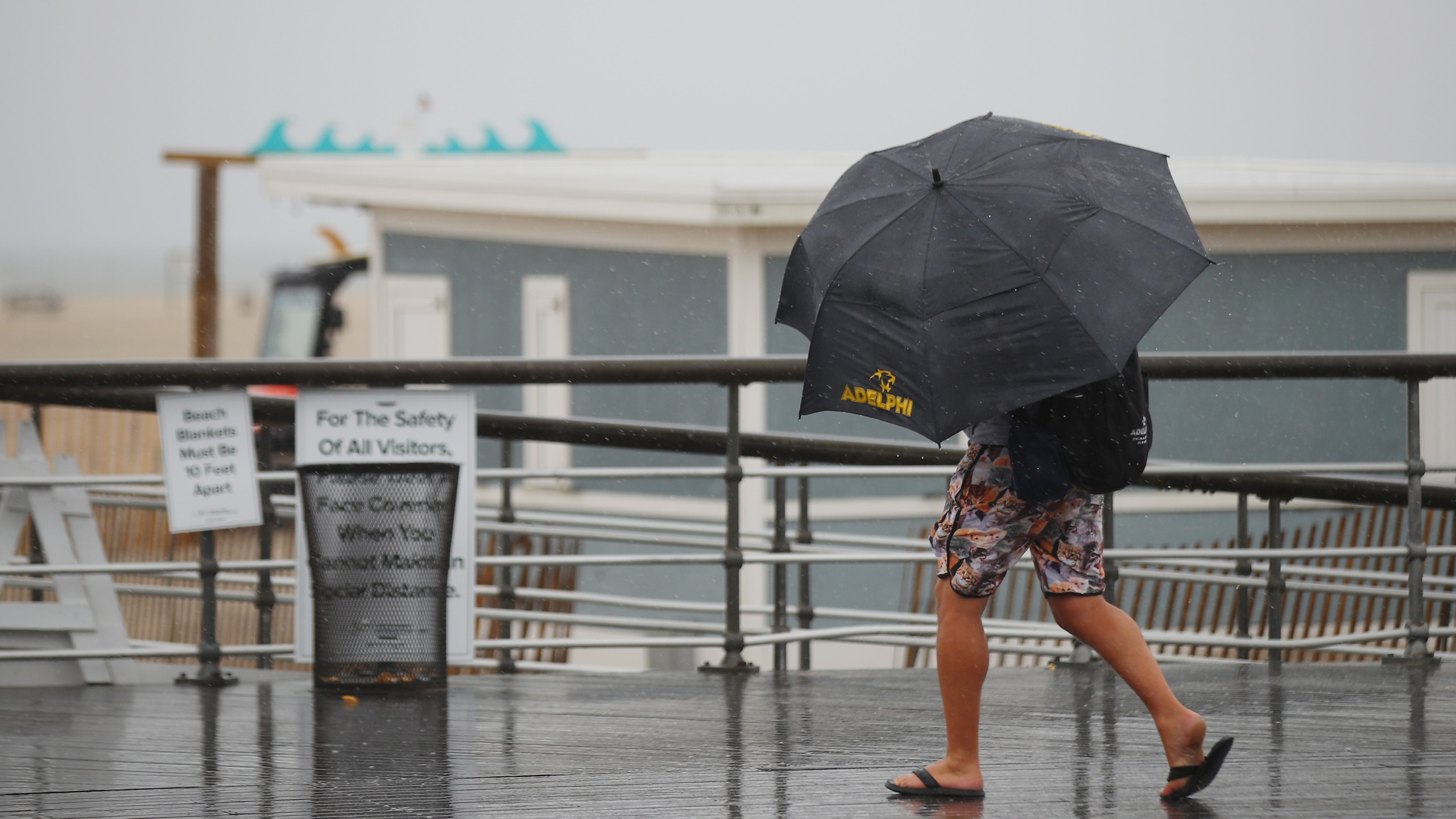 Visitors walk the boardwalk in rainy weather at Jones Beach on July 10, 2020, in Wantagh, New York. The Long Island region is bracing for Tropical Storm Fay as it moves along the eastern seaboard. (Bruce Bennett/Getty Images)