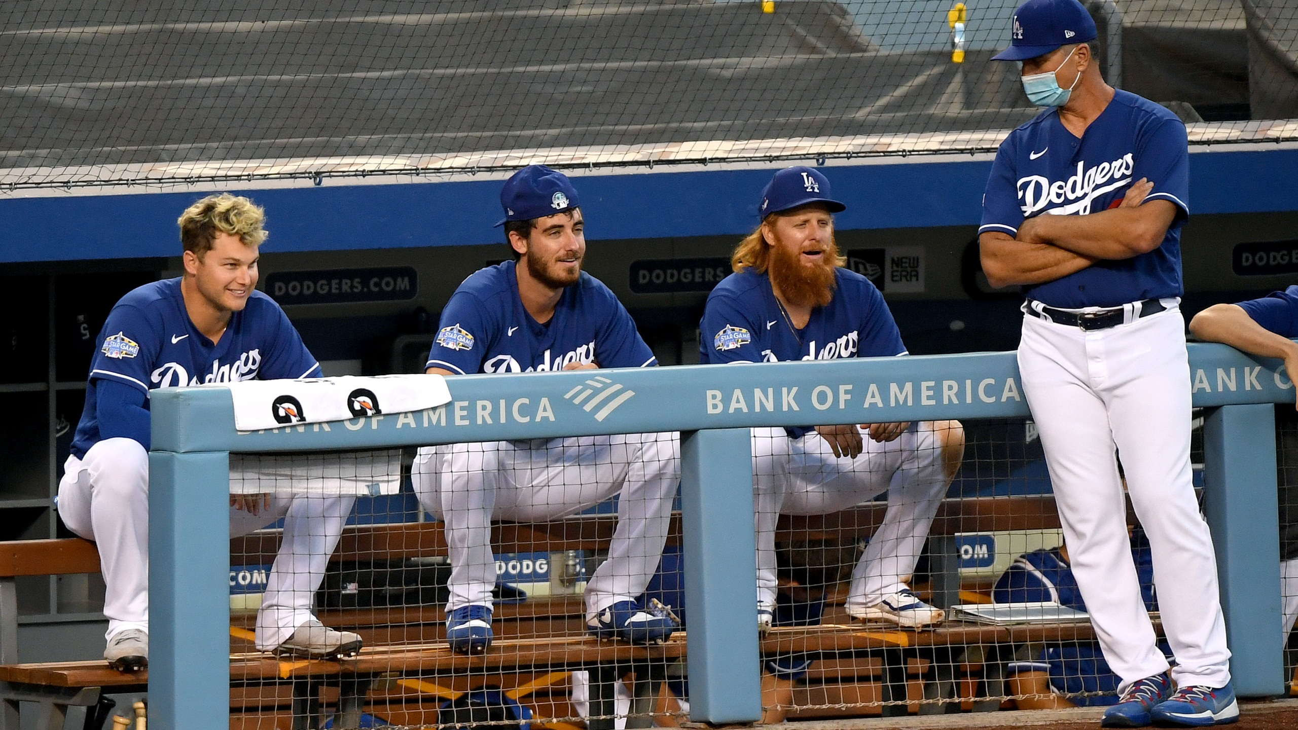 Joc Pederson, Cody Bellinger, Justin Turner and Bob Geren talk during the Los Angeles Dodgers summer camp workout in preparation for the 2020 season at Dodger Stadium on July 14, 2020. (Harry How/Getty Images)