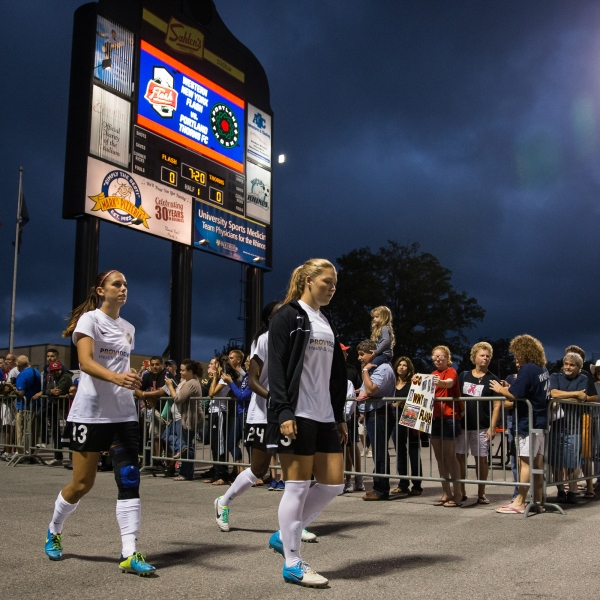 Alex Morgan, left, of Portland Thorns FC enters the field as a non-starting player at the National Women's Soccer League Championship against Western New York Flash at Sahlen's Stadium on Aug. 31, 2013 in Rochester, New York. (Brett Carlsen/Getty Images)