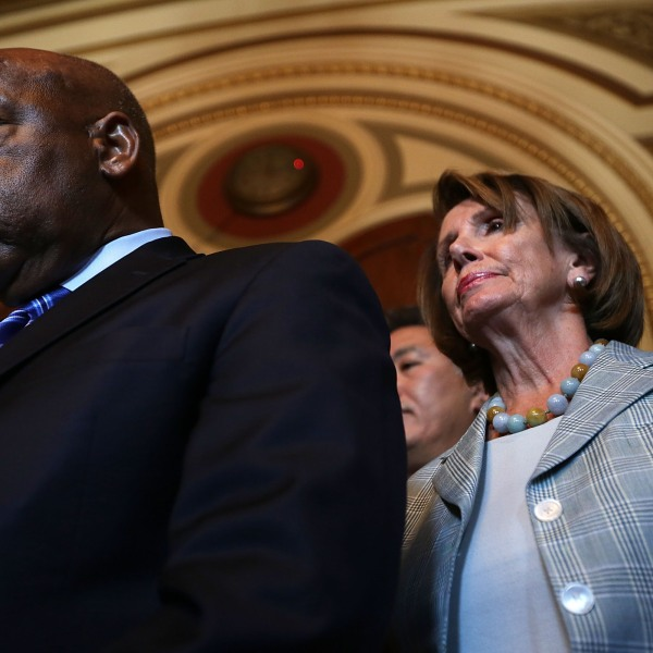 U.S. Rep. John Lewis (D-GA) and House Democratic Leader Rep. Nancy Pelosi (D-CA) listen during a news conference on LGBT discrimination on July 23, 2015 on Capitol Hill in Washington, D.C. (Alex Wong/Getty Images)