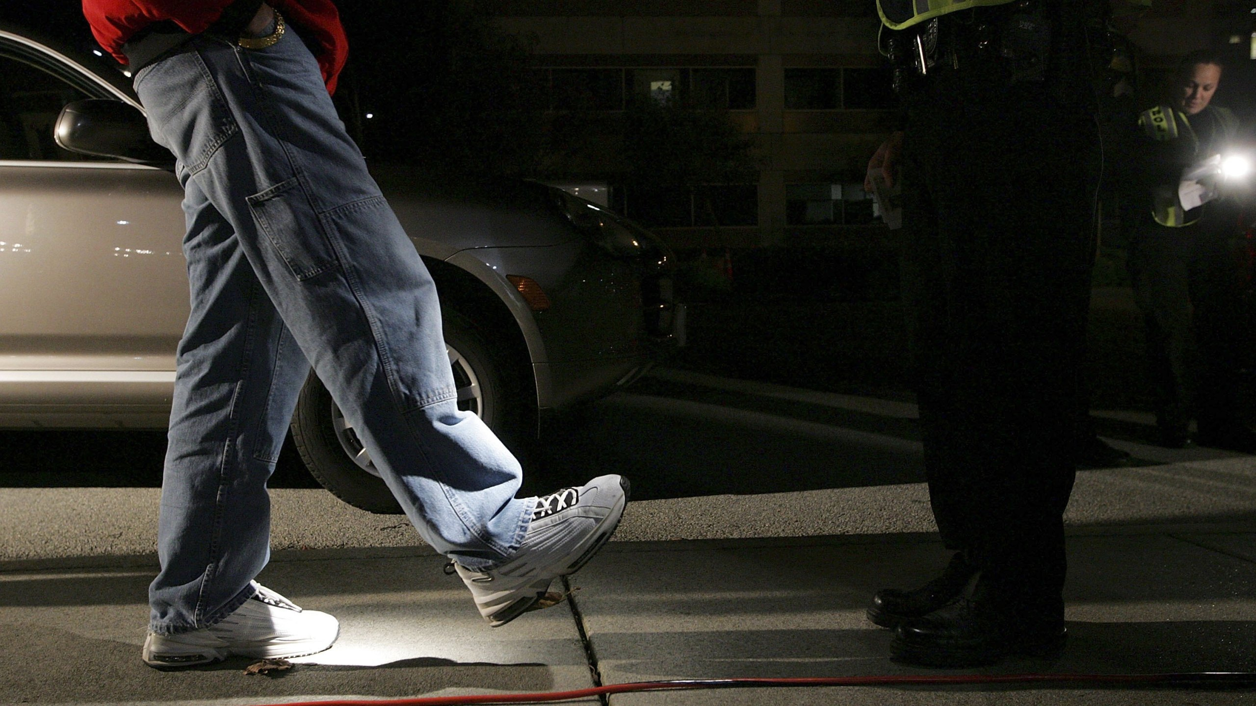 A man is given a field sobriety test after he was stopped by police officers at a DUI checkpoint in San Bruno in this file photo from Nov. 27, 2006. (Justin Sullivan/Getty Images)