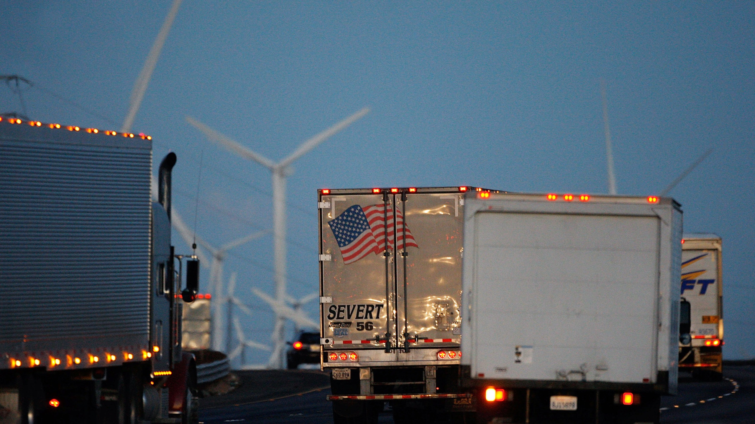 Trucks pass windmills on the 10 Freeway on Dec. 8, 2009 near Banning. (David McNew/Getty Images)