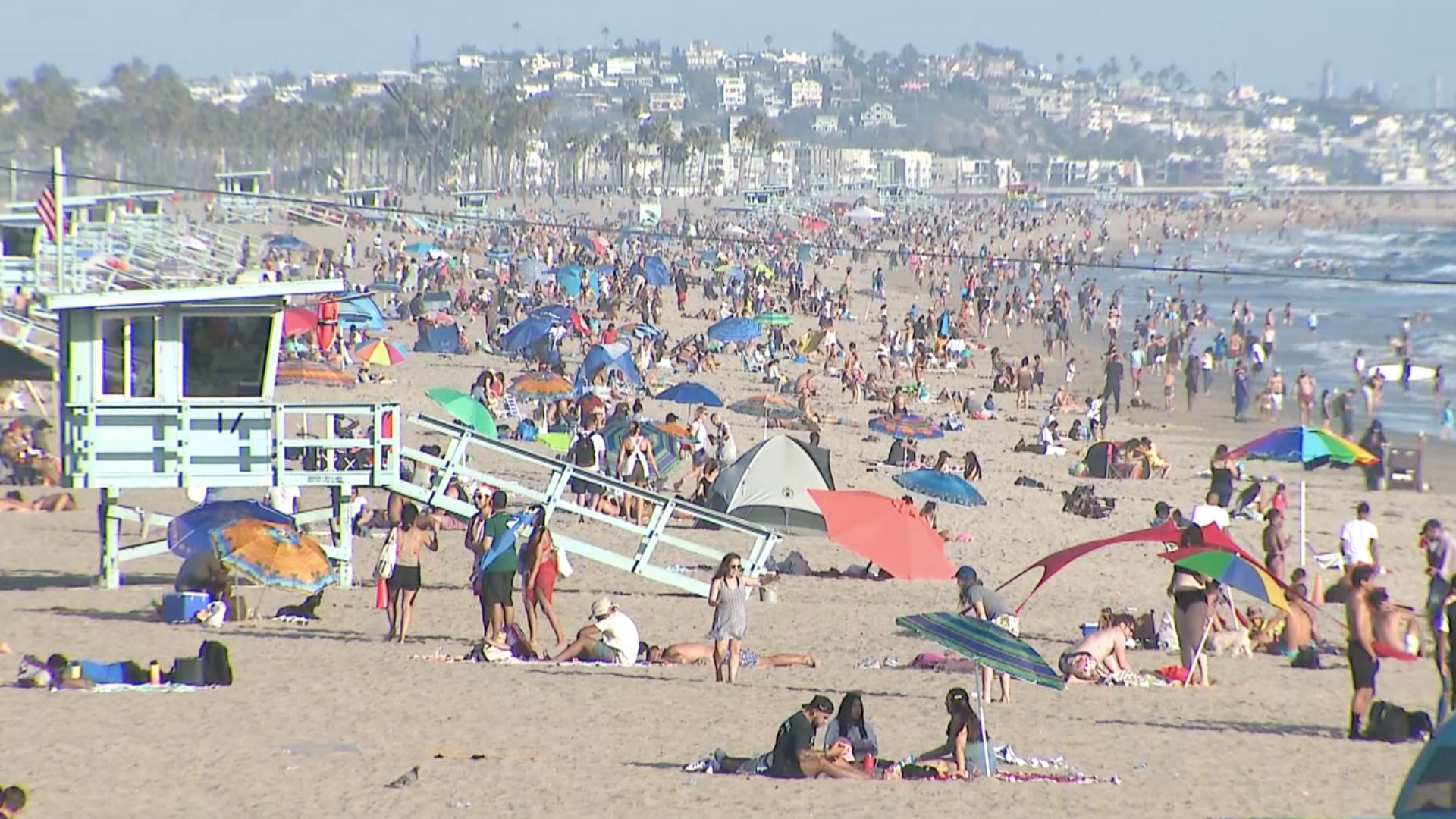 Beachgoers cool down in Santa Monica on July 11, 2020. (KTLA)
