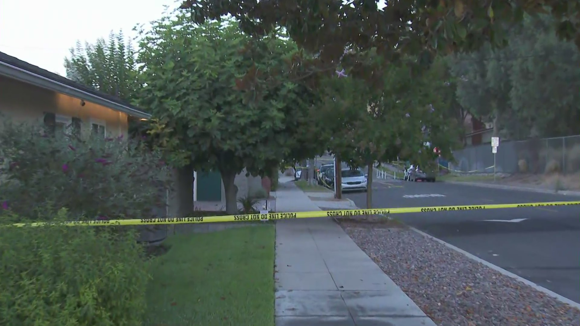 A crime scene tape surrounds a home where a deadly shooting investigation was underway on July 21, 2020. (KTLA)