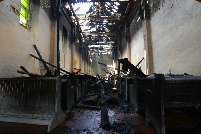A fire burned most of San Gabriel Mission's roof and interior in July 2020. Here, some of the destroyed building is seen in the days after. (Carolyn Cole / Los Angeles Times)