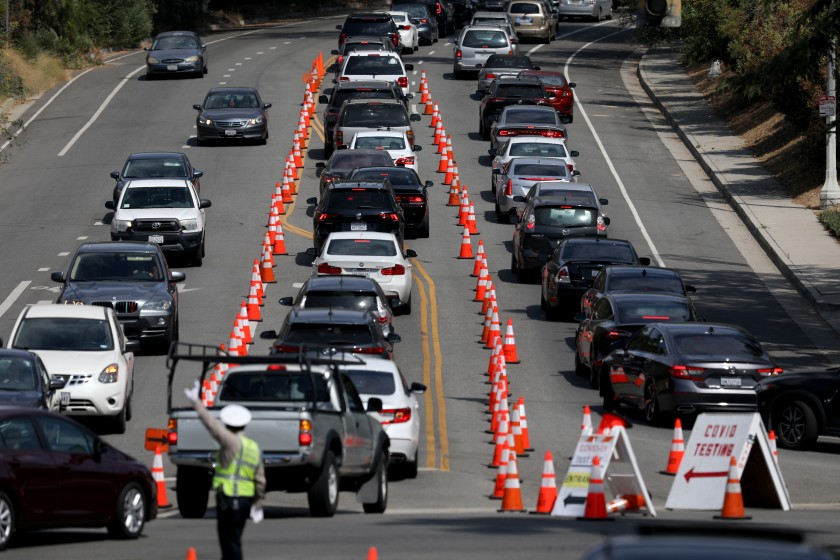 Cars line up for drive-through coronavirus testing at Dodger Stadium in Los Angeles. (Gary Coronado / Los Angeles Times)