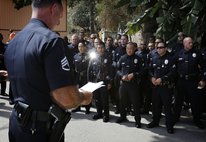 A sergeant speaks to a platoon of LAPD Metropolitan Division officers deployed in 2015 as part of an effort to reduce crime.(Barbara Davidson / Los Angeles Times)