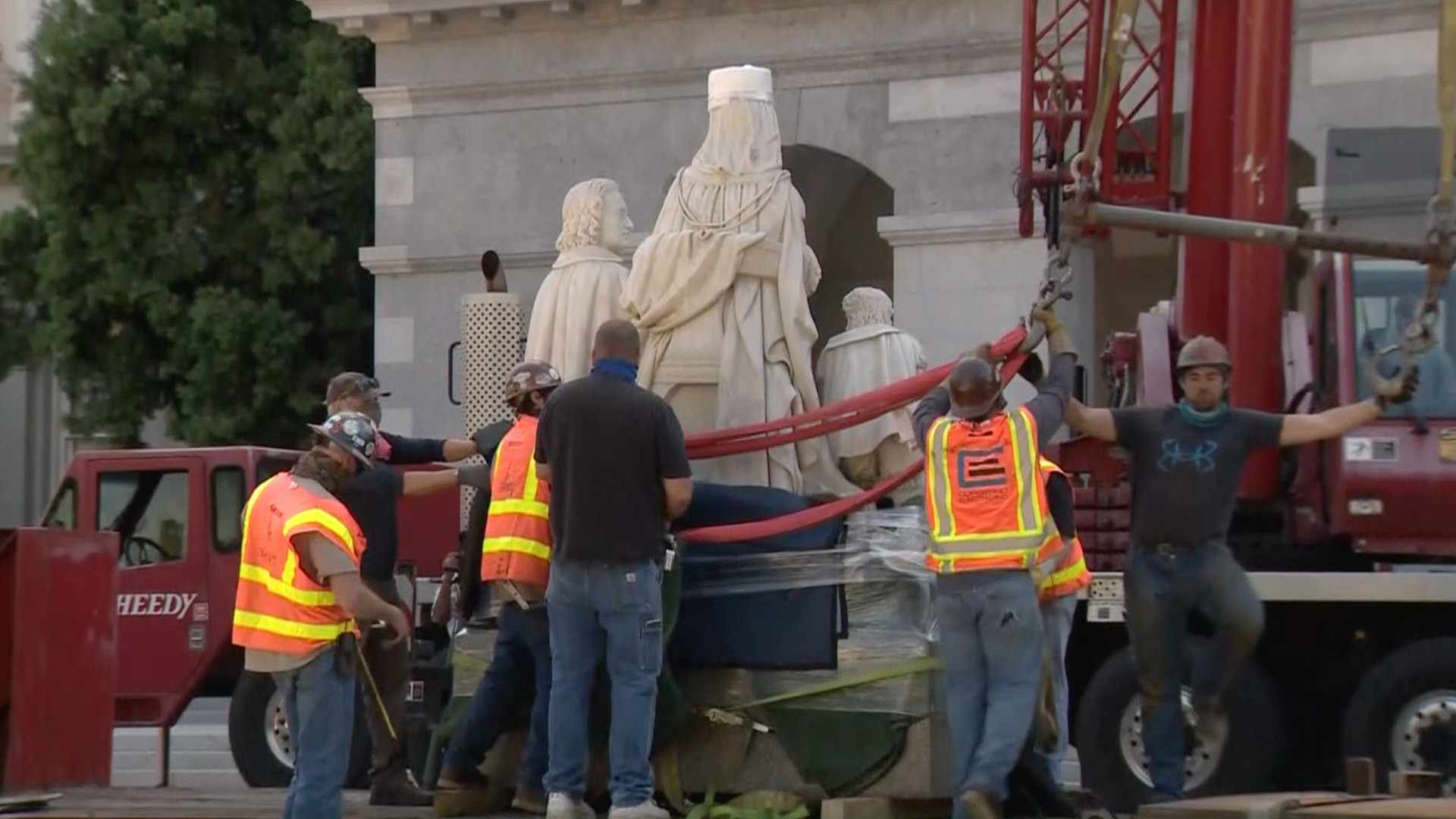 Crews remove a statue of Christopher Columbus and Queen Isabella from the California state Capitol on July 7, 2020. (KCRA via CNN)