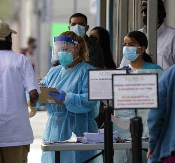 Healthcare workers screen patients on July 29, 2020, at St. John's Well Child and Family Center in Los Angeles.(Irfan Khan / Los Angeles Times)