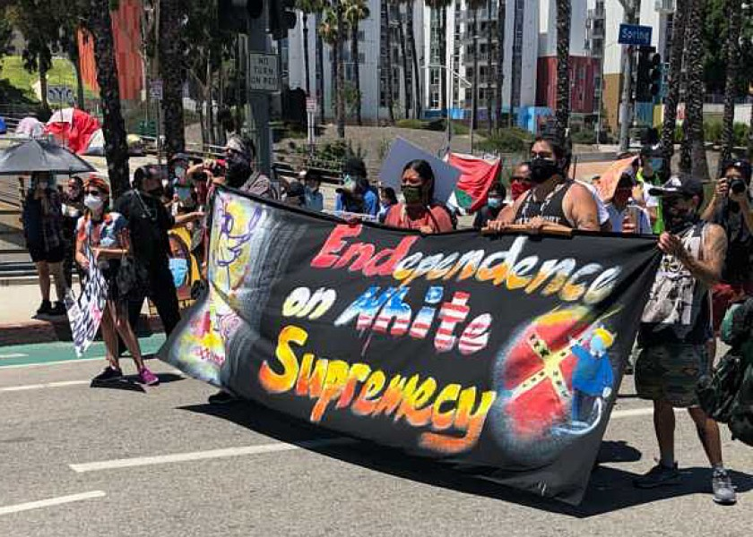 Demonstrators gather on July 4, 2020, near Olvera Street in Los Angeles.(Andrew J. Campa / Los Angeles Times)