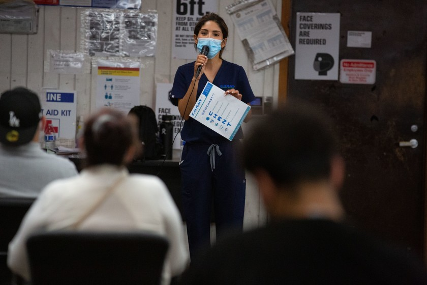 Los Angeles Apparel holds a health and safety training session for its employees on July 15, 2020, after the South L.A. garment factory was shut down by county officials due to more than 300 coronavirus cases and four worker deaths. (Jason Armond / Los Angeles Times)