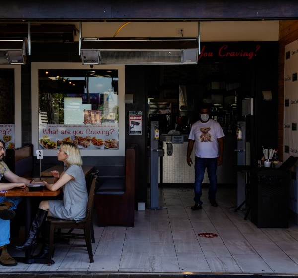 AJ Shalob, right, stands in his family-owned Studio City restaurant, Crave Cafe, in this undated photo. (Kent Nishimura / Los Angeles Times)