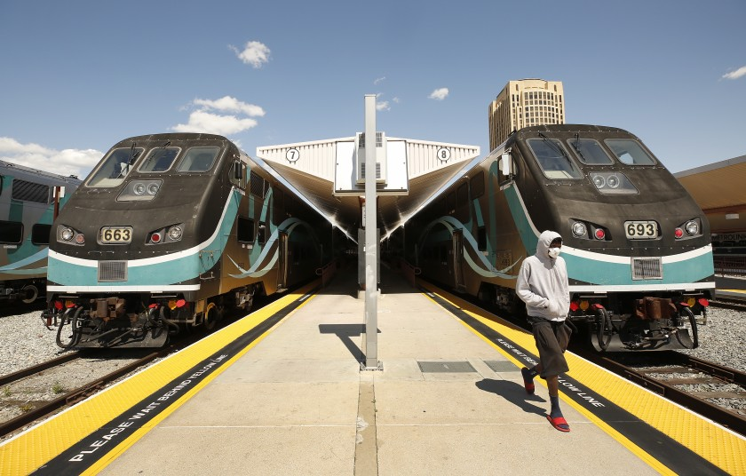 A passengers waits to board a Metrolink train to San Bernardino as other Metrolink trains stand idle at Union Station. (Al Seib/Los Angeles Times)