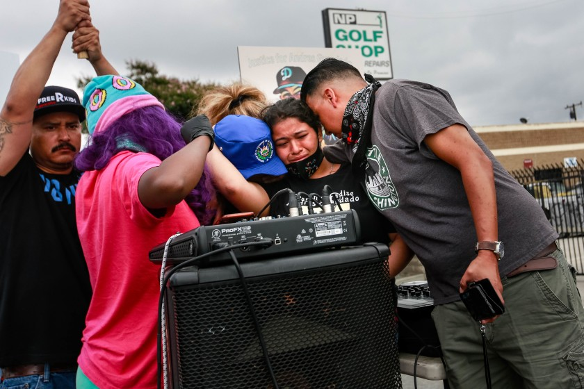 Jennifer Guardado, sister of Andres Guardado, who was fatally shot by a sheriff's deputy in Gardena, and other relatives of speak at the rally seeking justice for Andres Guardado (Jason Armond/Los Angeles Times)