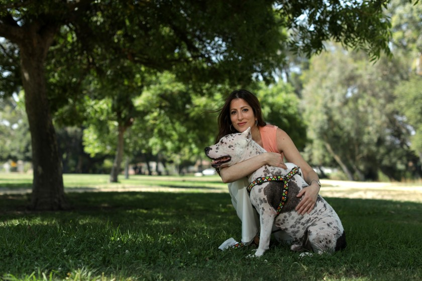 Natalia Soto, with her dog Moo, is a veterinary surgeon who says Marc Ching gave bad medical advice to a client whose dog was suffering from bladder stones.(Myung J. Chun / Los Angeles Times)