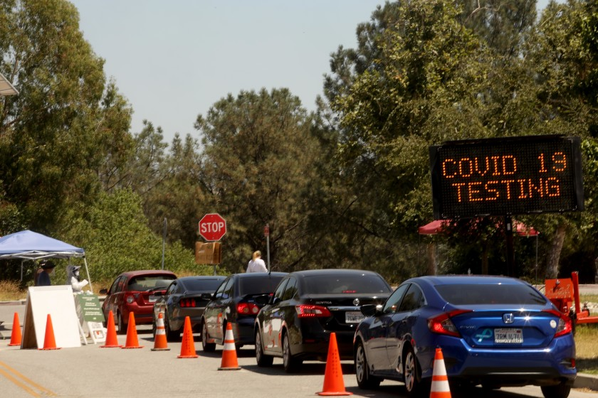 Cars are lined up at a COVID-19 testing site at the Hansen Dam Recreation Center in Sylmar on Tuesday.(Genaro Molina / Los Angeles Times)