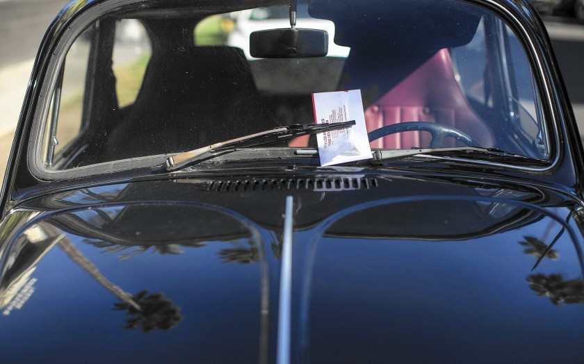 A parking ticket sits on a vintage Volkswagen in this undated file photo. (Gina Ferazzi / Los Angeles Times)