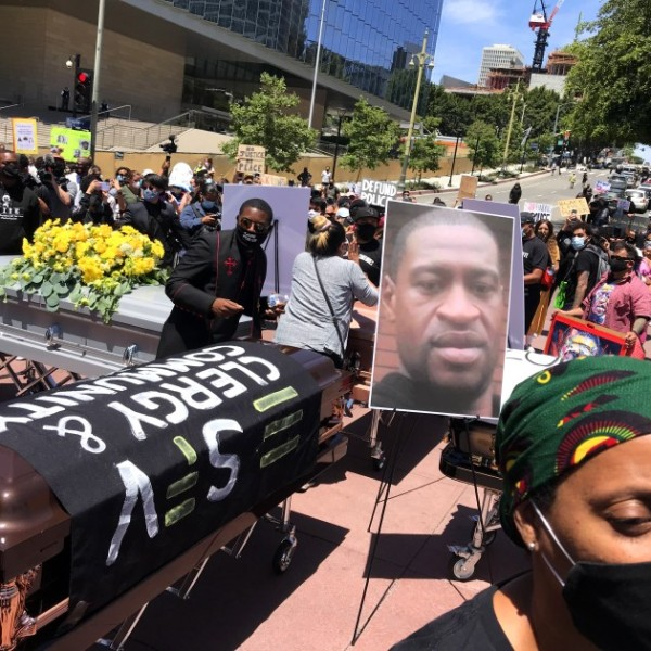 Protesters display four coffins in memory of George Floyd and others killed by police nationwide in downtown Los Angeles in June 2020. (Genaro Molina /Los Angeles Times)