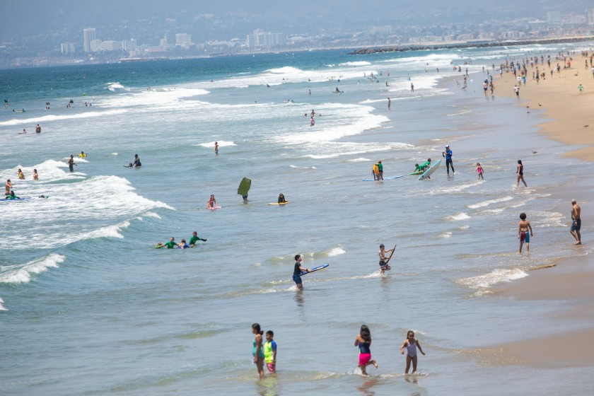 Scenes from Manhattan Beach on July 2, 2020, the day before Los Angeles County beaches were closed for the Fourth of July holiday weekend.(Jay L. Clendenin / Los Angeles Times)