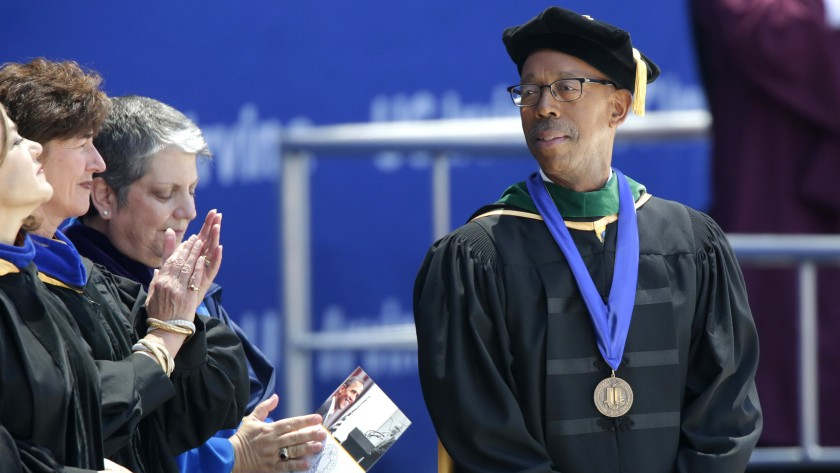 Then-UC Irvine Chancellor Michael V. Drake, right, stands beside UC President Janet Napolitano at UCI's class of 2014 commencement ceremony held at Angel Stadium of Anaheim.(Irfan Khan / Los Angeles Times)