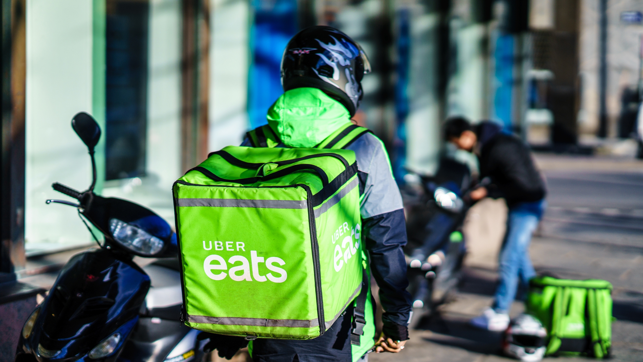 Less than a month after Uber tried and failed to buy GrubHub, the ride-hailing company has won a different deal to bolster its food delivery business. (Shutterstock via CNN Wire)