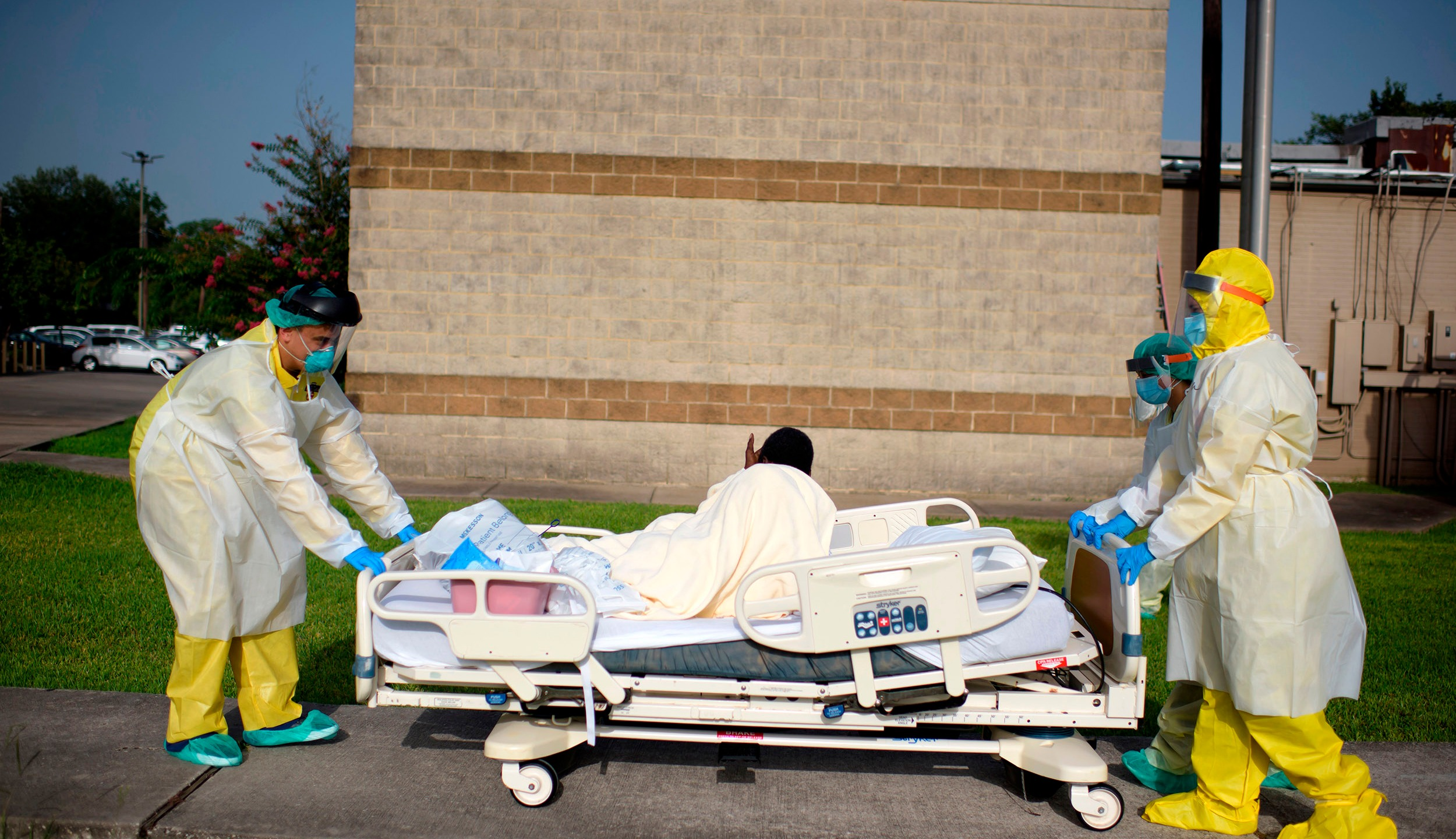Health care workers push a patient into a less intensive unit from the COVID-19 unit at United Memorial Medical Center in Houston, Texas on July 2, 2020. (MARK FELIX/AFP via Getty Images)