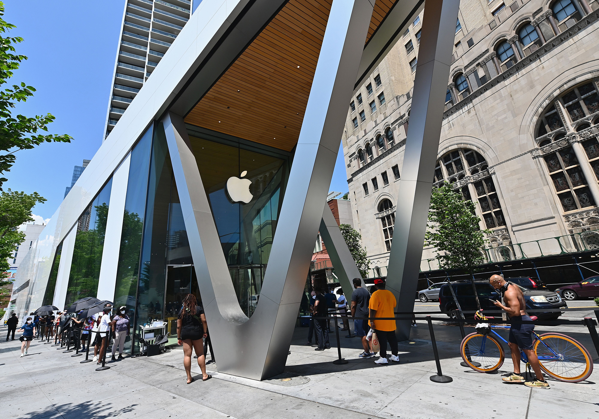 People wait in line outside an Apple store on June 22, 2020 in New York City. (ANGELA WEISS/AFP via Getty Images)