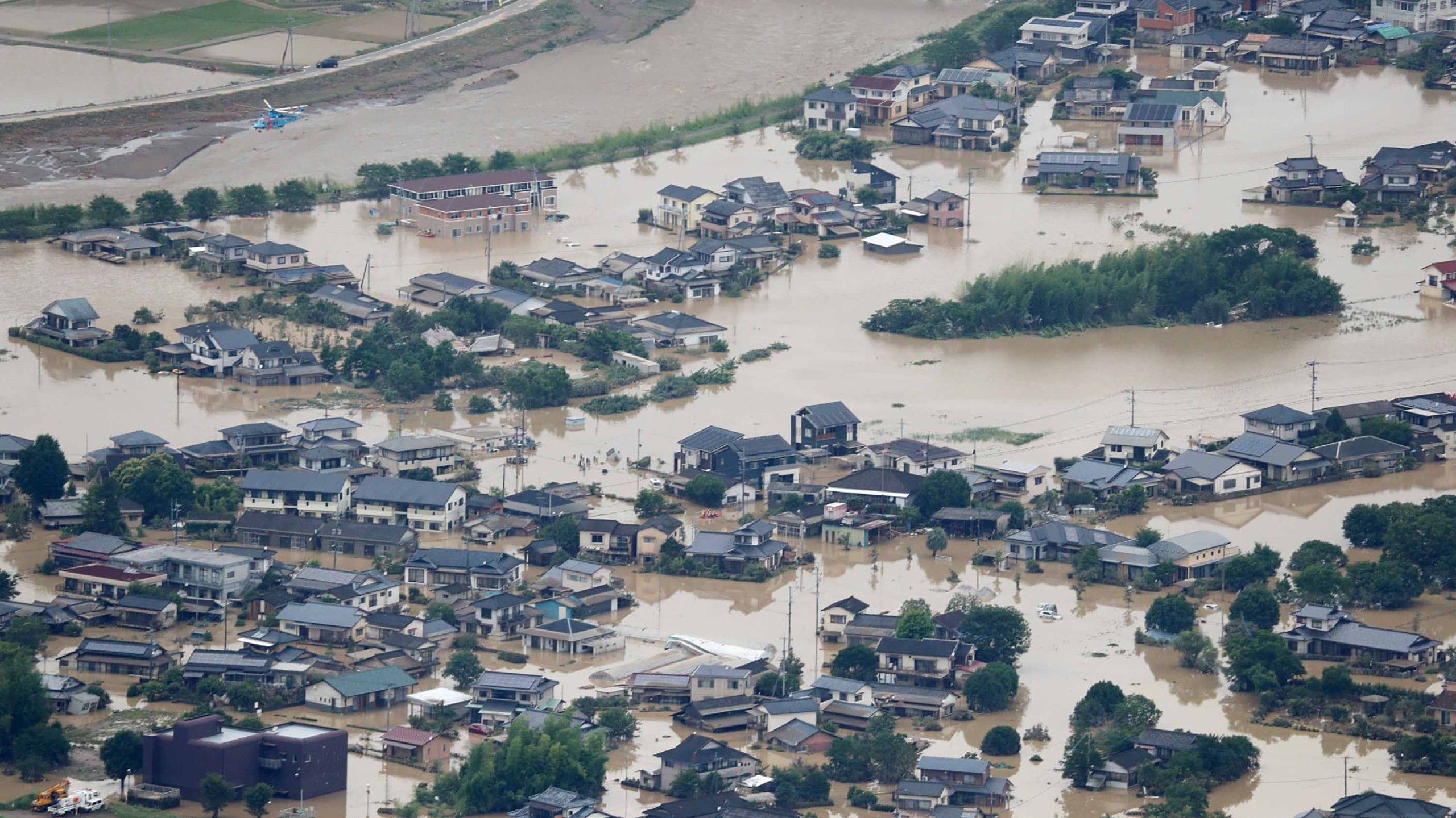 This picture shows inundated houses due to heavy rain in Hitoyoshi, Kumamoto prefecture on July 4, 2020. (STR/JIJI PRESS/AFP via Getty Images)