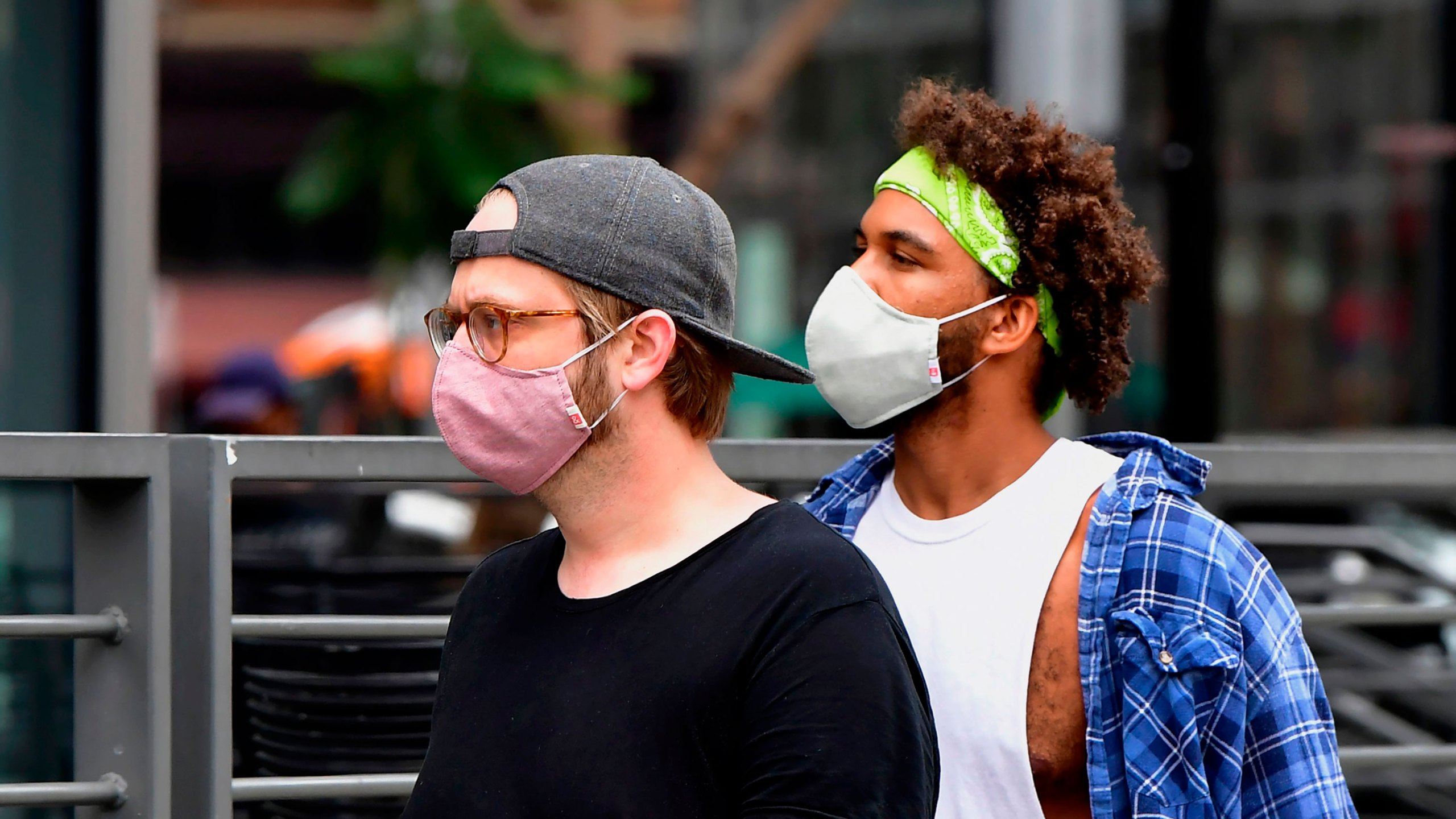 Young men wearing facemasks due to the coronavirus pandemic are seen in Los Angeles on June 29, 2020. (FREDERIC J. BROWN/AFP via Getty Images)