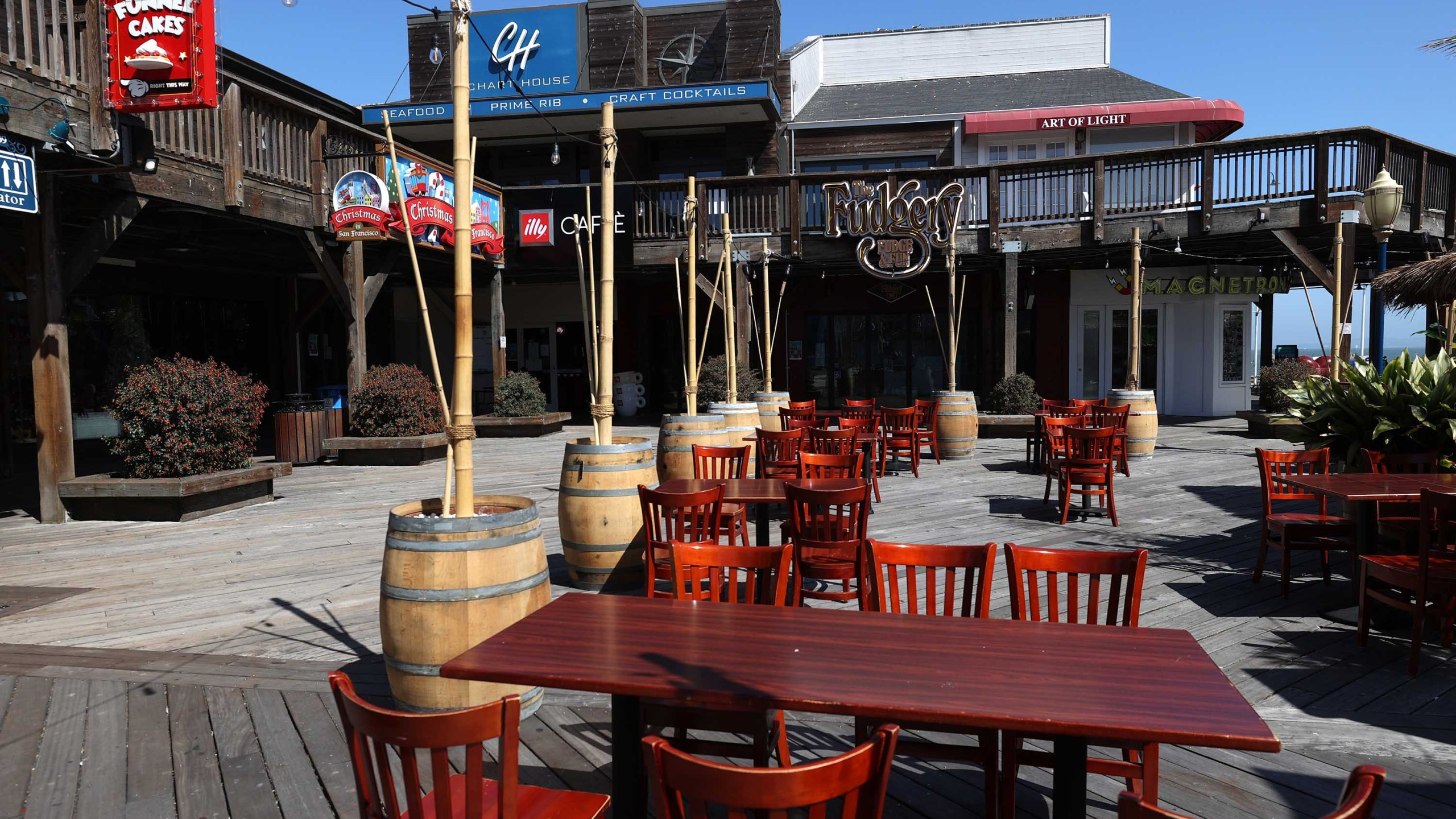 Restaurant tables sit empty at the tourist destination Pier 39 on July 09, 2020, in San Francisco. (Justin Sullivan/Getty Images)