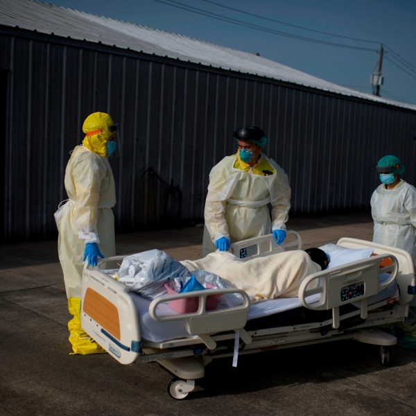 Healthcare workers push a patient from the Covid-19 Unit at United Memorial Medical Center in Houston. (Mark Felix/AFP/Getty Images)