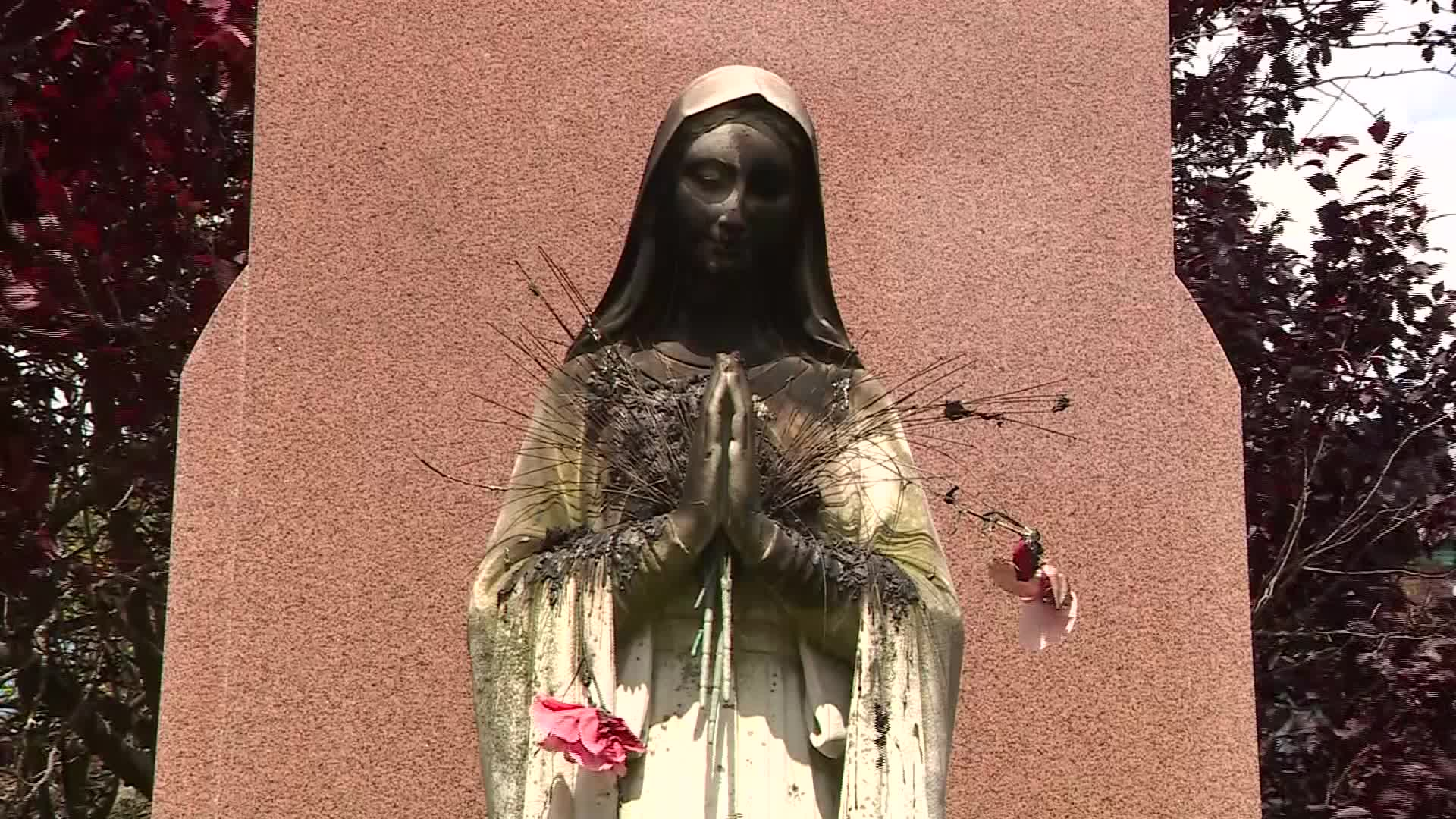 A Virgin Mary statue was burned outside the Saint Peter Parish Church in Boston, MA, on July 11, 2020.(WCVB)