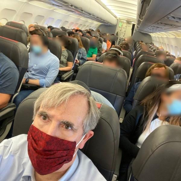 Senator Jeff Merkley takes a picture of a crowded American Airlines flight. (Senator Jeff Merkley via Twitter)