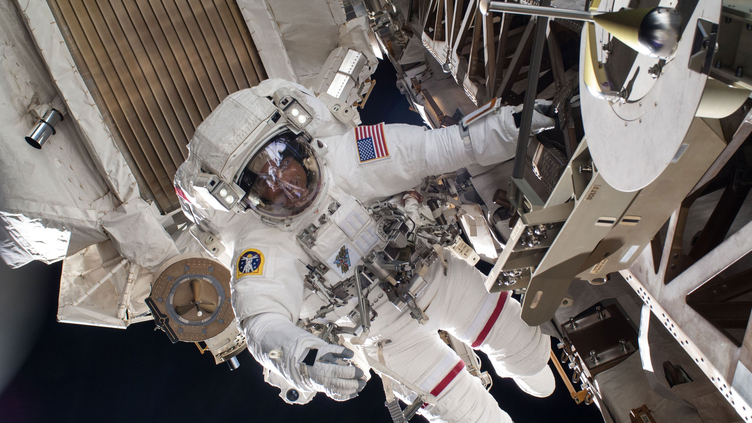 NASA astronauts Chris Cassidy and Robert Behnken began a spacewalk outside of the International Space Station to replace lithium ion batteries for one of the station's power channels On July 1, 2020. (NASA via CNN Wire)