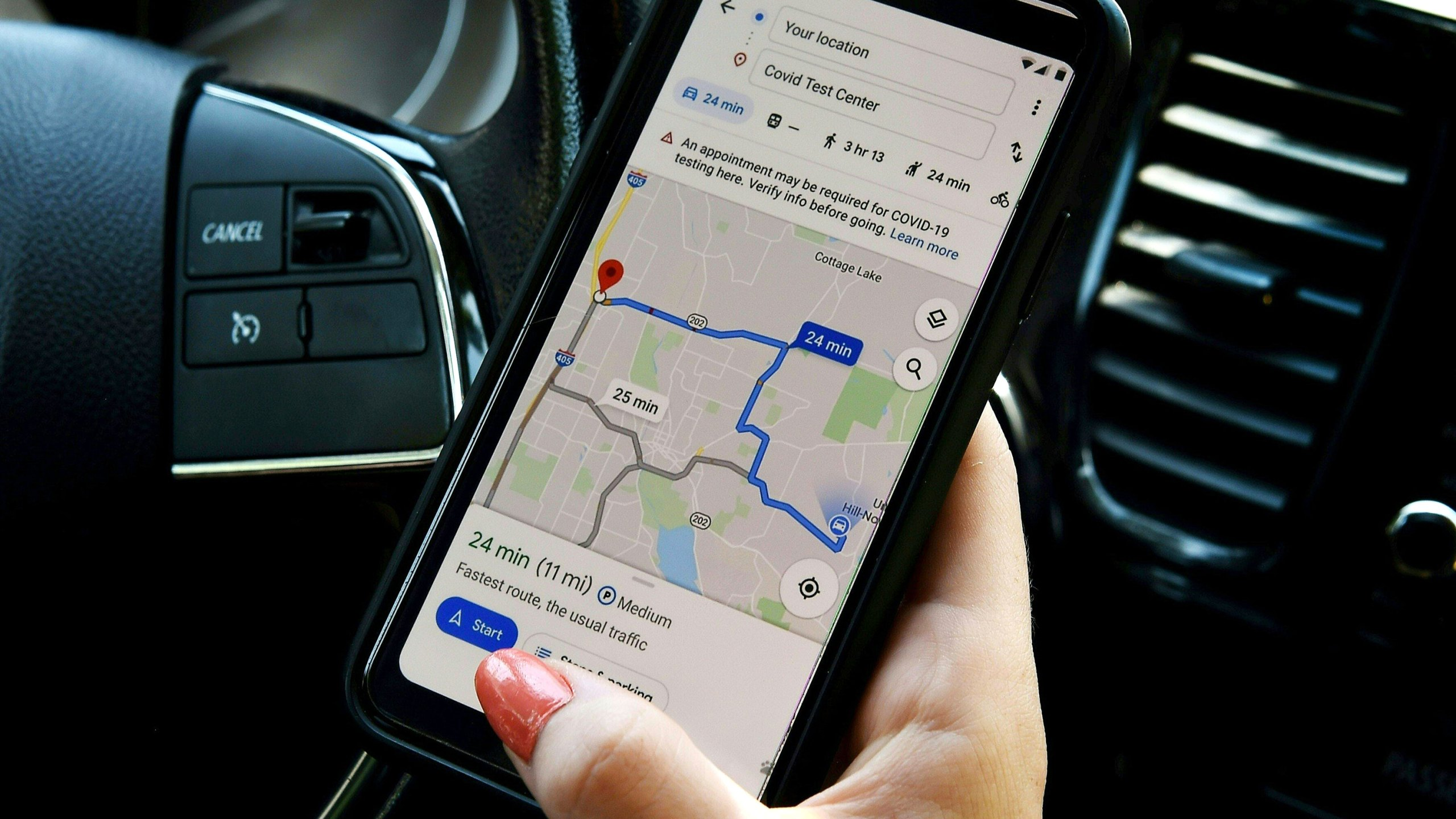 A Google map application displays a medical facility on a smartphone in Arlington, Virginia on June 9, 2020. (OLIVIER DOULIERY/AFP via Getty Images)
