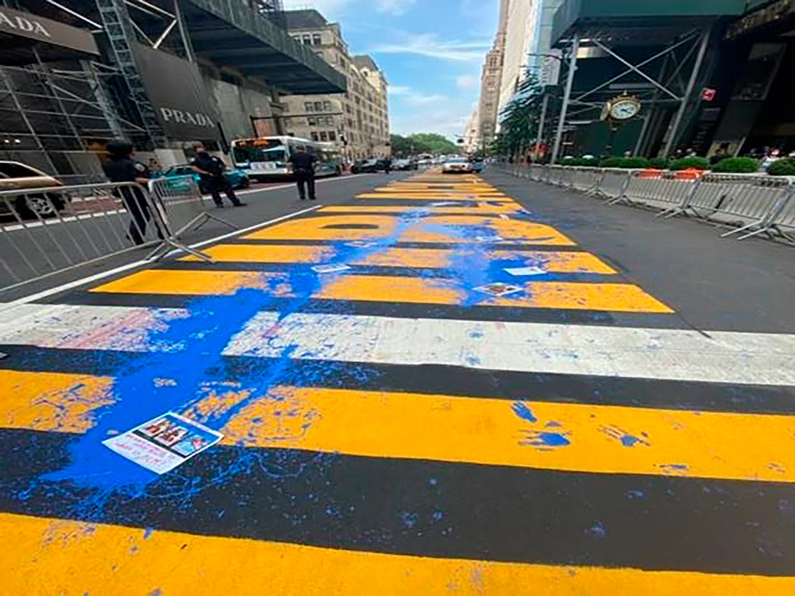 This photo provided by the New York City Police Department shows the Black Lives Matter mural in front of Trump Tower defaced with blue paint, Friday, July 17, 2020 in New York. (New York Police Department via AP)