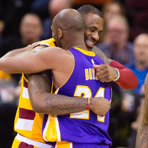Kobe Bryant and LeBron James hug during the first half at Quicken Loans Arena on Feb. 10, 2016, in Cleveland, Ohio. (Jason Miller/Getty Images via CNN)