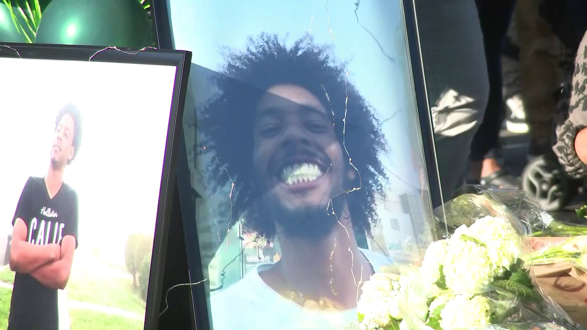 Photos of Jakeil Reynolds are displayed at a vigil held July 24, 2020, near where he was fatally shot days before in Ladera Heights. (KTLA)