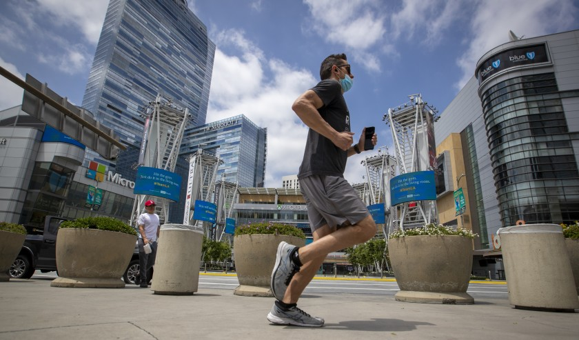 A jogger passes L.A. Live in downtown Los Angeles in June 2020.(Allen J. Schaben / Los Angeles Times)