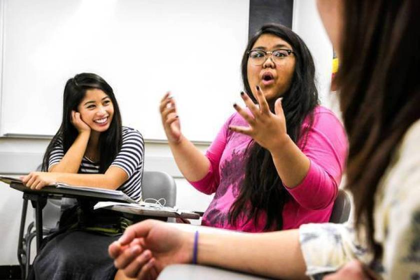 Kyla Artigo, 20, center, speaks during an Asian American studies class at Cal State Long Beach in 2013. (Ricardo DeAratanha / Los Angeles Times)