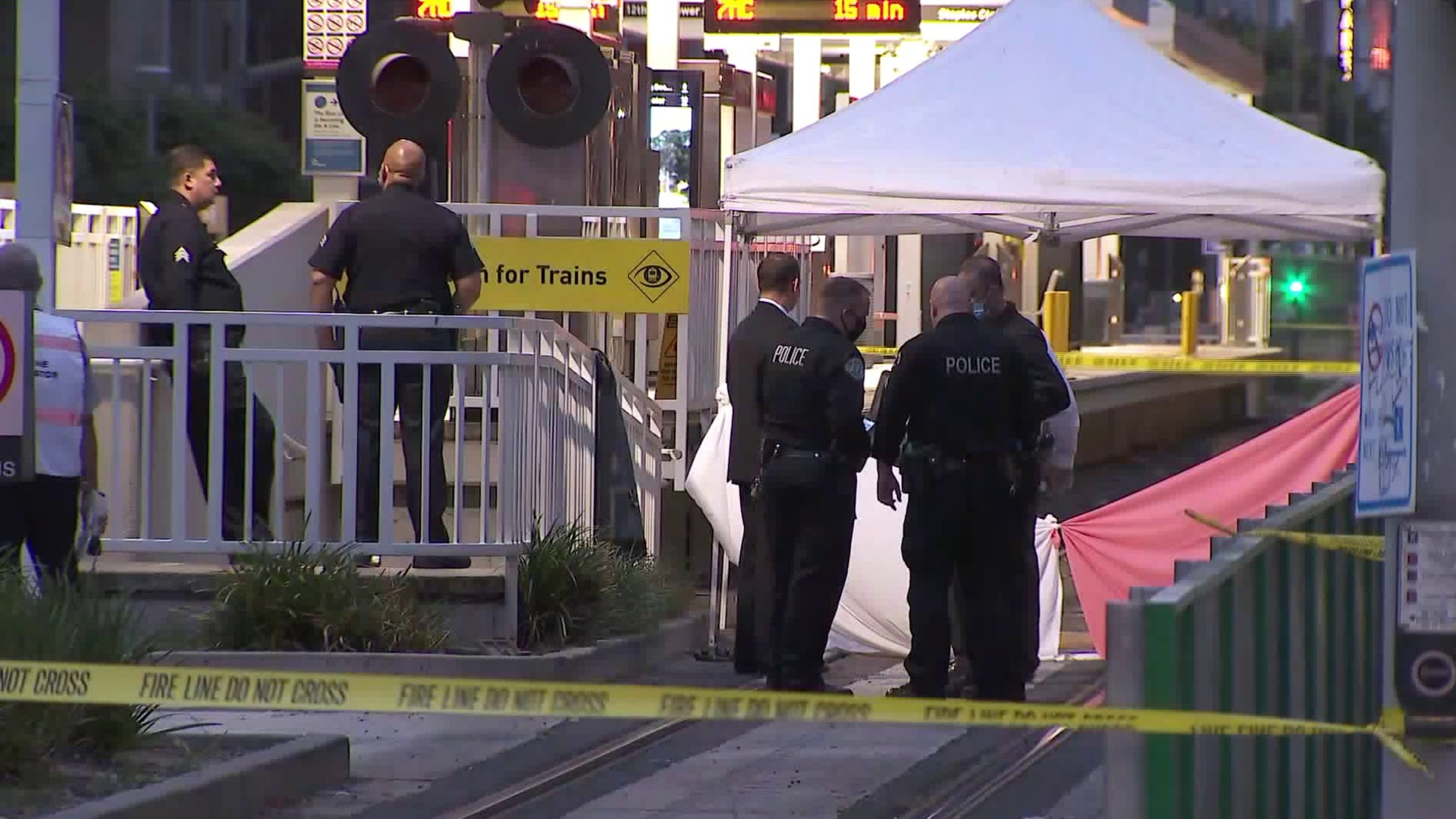 Investigators stand near a canopy at the Pico Station in downtown Los Angeles on July 2, 2020. (KTLA)
