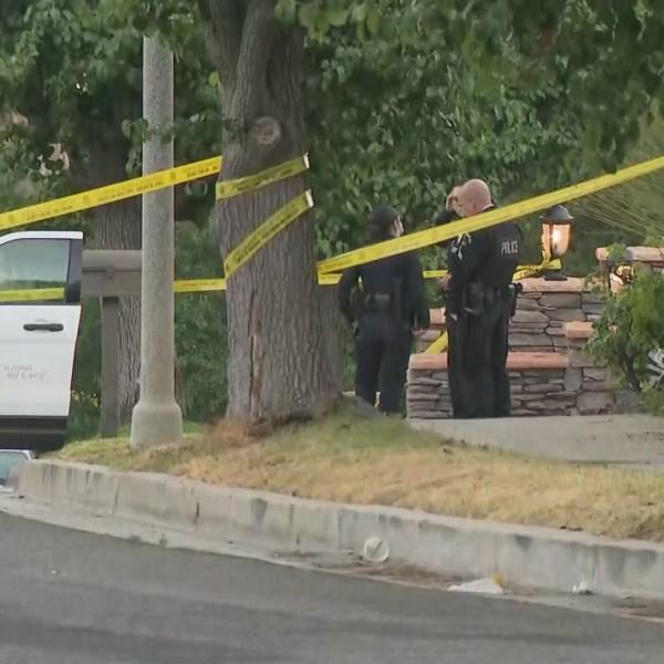 Police investigate a fatal shooting in Encino on July 27, 2020. (KTLA)