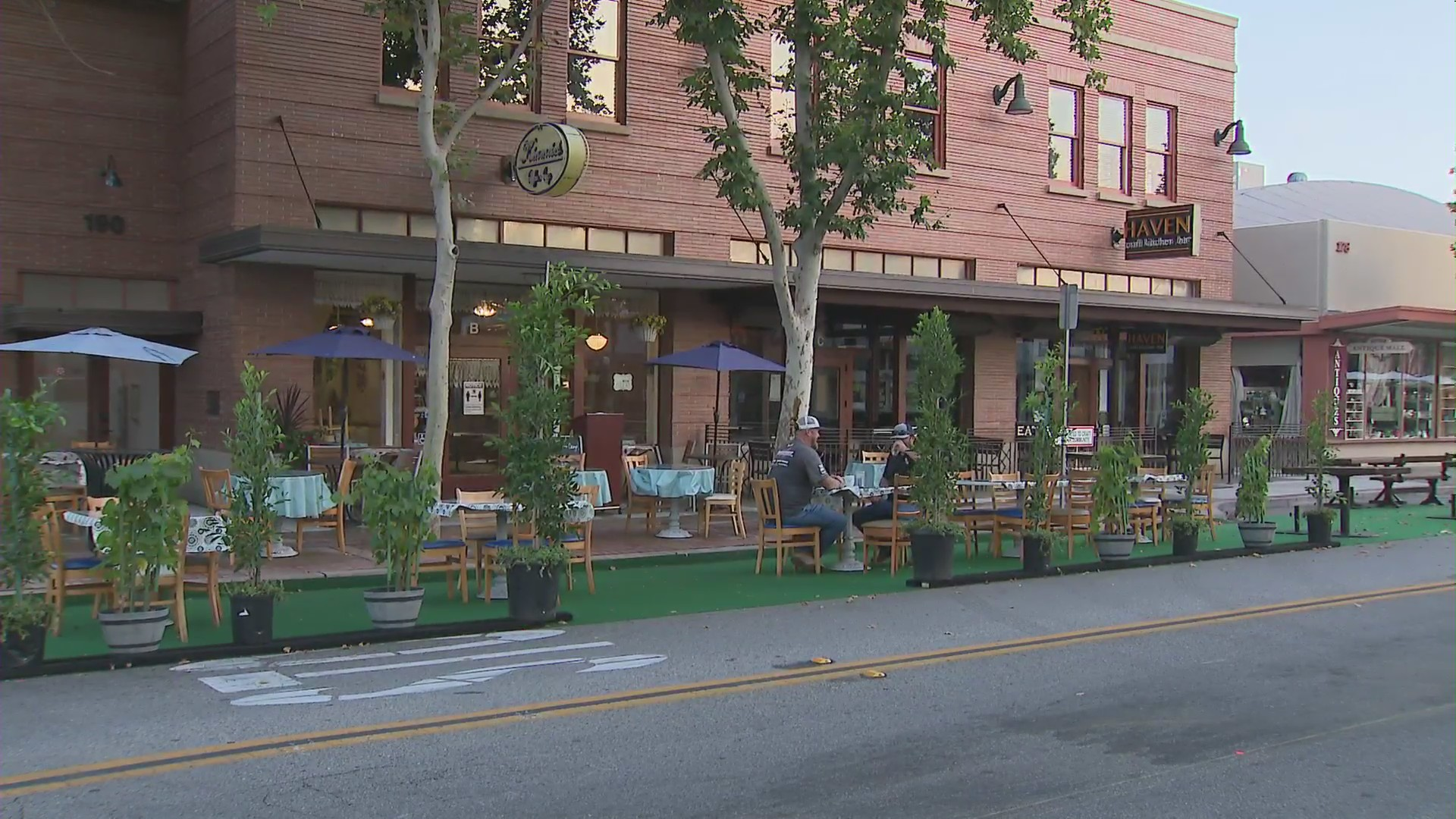 A pair of diners eat outdoors at a restaurant in Old Towne Orange on July 10, 2020. (KTLA)